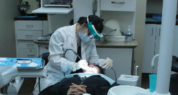 Dental Suite with hygenist and person