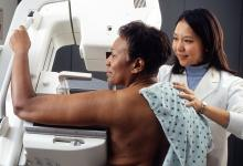 Black woman being screened for breast cancer with mammography.