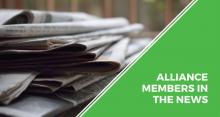 Alliance members in the news text graphic with picture of newspapers.