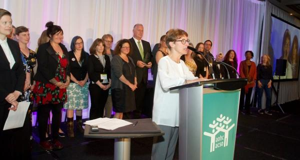 Lynne Raskin, CEO of South Riverdale Community Health Centre, speaks while accepting a Transformative Change Award for the centre's role in achieving government approval for supervised injection services.